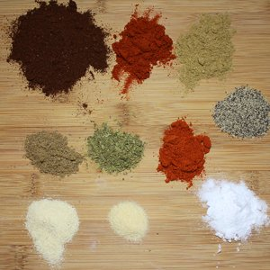 All of the components of taco seasoning individually on a board