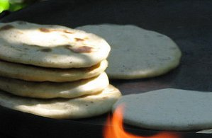 A stack of thick corn tortillas